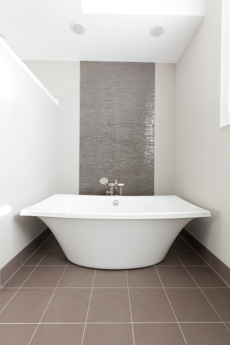 Soaking Tub alcove with glass mosaic tile