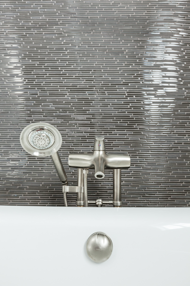 Glass tile whirlpool and tub filler