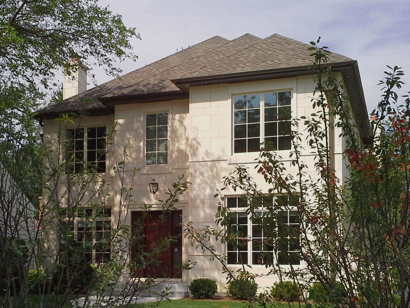 New Construction French Manor styled home with cut stone exterior in Elmhurst, IL.