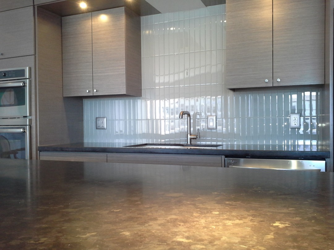 Glass tile back splash and honed granite kitchen island