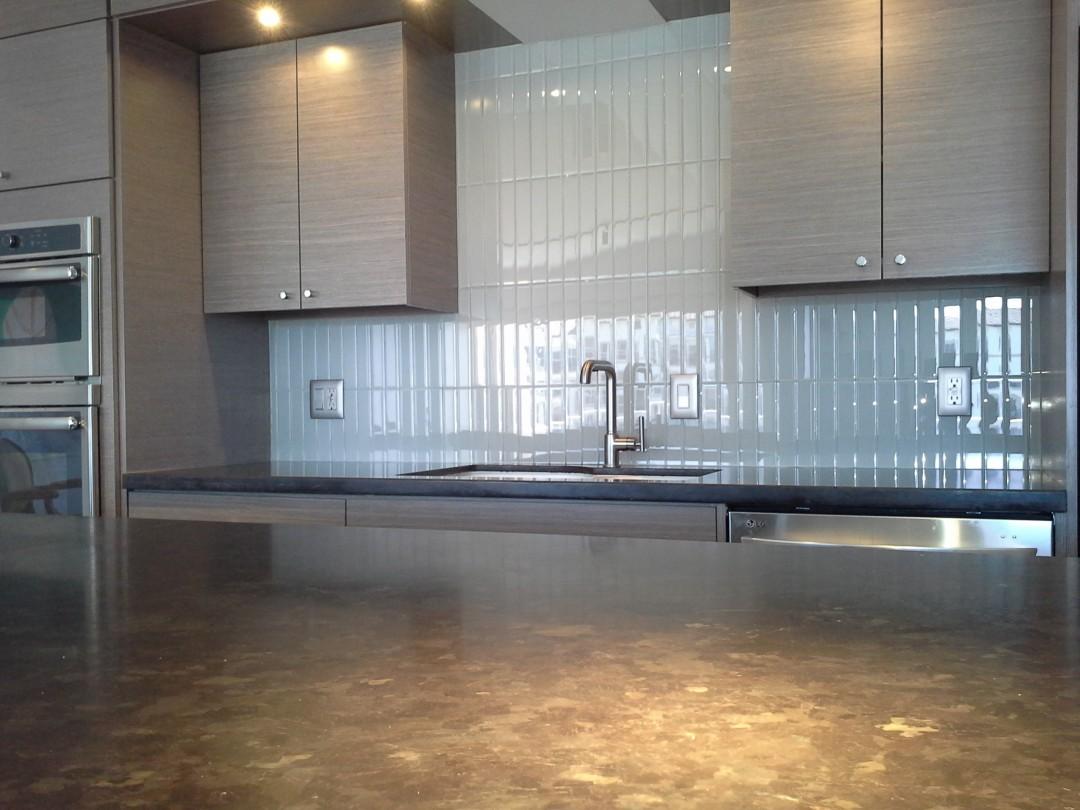 Glass tile back splash and honed granite kitchen island